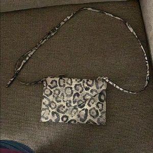 Snakeskin cross over bag.